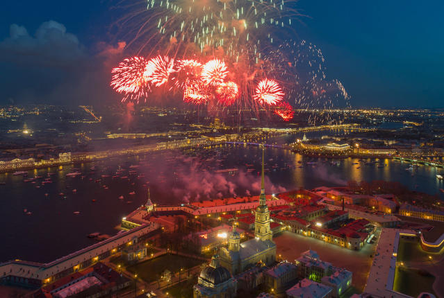 <p>Fireworks explode over the Saint Peter and Paul Fortress and the Neva River during celebration of the 72nd anniversary of the defeat of the Nazis in World War II in St. Petersburg, Russia, on May 9, 2017. (Photo: Dmitri Lovetsky/AP) </p>