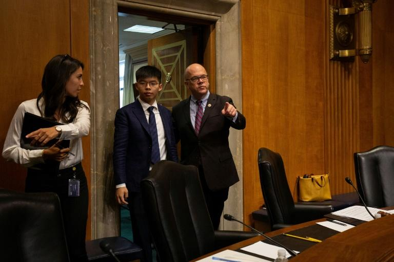 Hong Kong pro-democracy activist Joshua Wong and US Representative Jim McGovern arrive for a hearing before the Congressional-Executive Commission on China