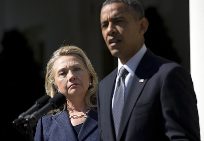 Secretary of State Hillary Rodham Clinton listens as President Barack Obama speaks on the death of U.S. ambassador to Libya Christopher Stevens, Wednesday, Sept. 12, 2012, in the Rose Garden of the White House in Washington. (AP Photo/Evan Vucci)