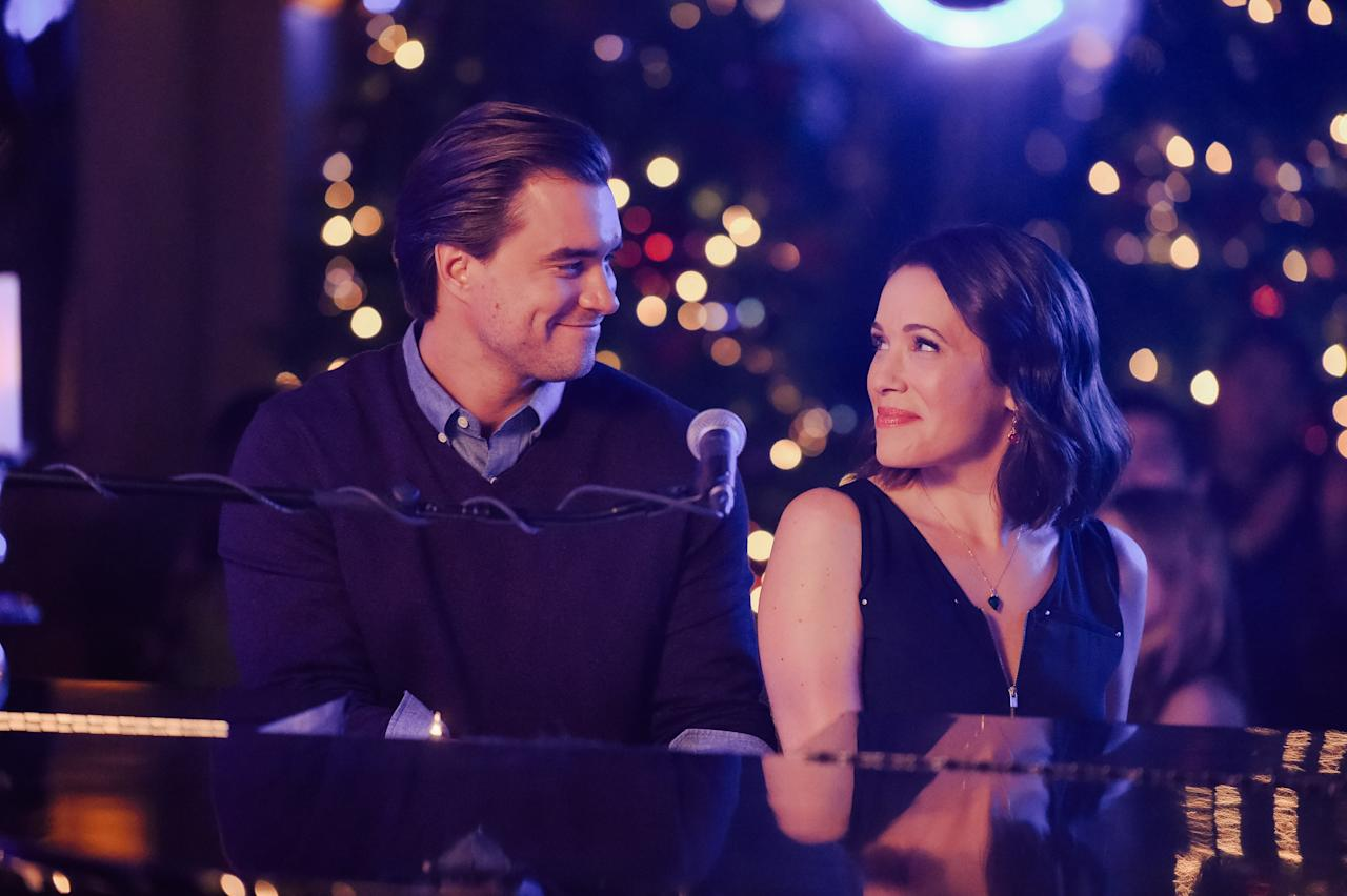 """<strong>Official synopsis:</strong> """"Two rival musicians, Lindsay (Marla Sokoloff) and Wes (Rob Mayes), who perform in a dueling piano show, suddenly find themselves without a gig on Christmas Eve and decide to road-trip to their neighboring hometowns together. During the drive, the mismatched pair find themselves surrounded by Santa conventioneers, saving a Christmas nativity play, performing onstage in Nashville with music royalty, and braving a massive snowstorm that just may lead them to making sweet music together."""""""