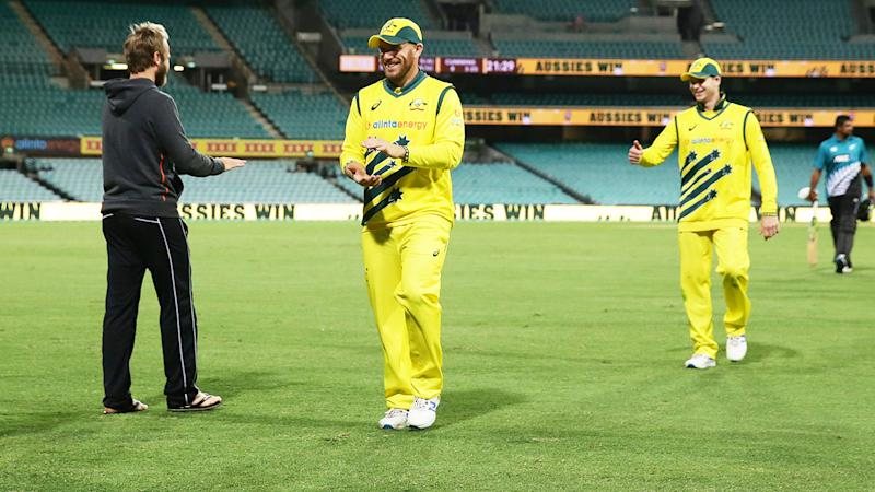Australia and New Zealand players, pictured here clapping each other instead of shaking hands.