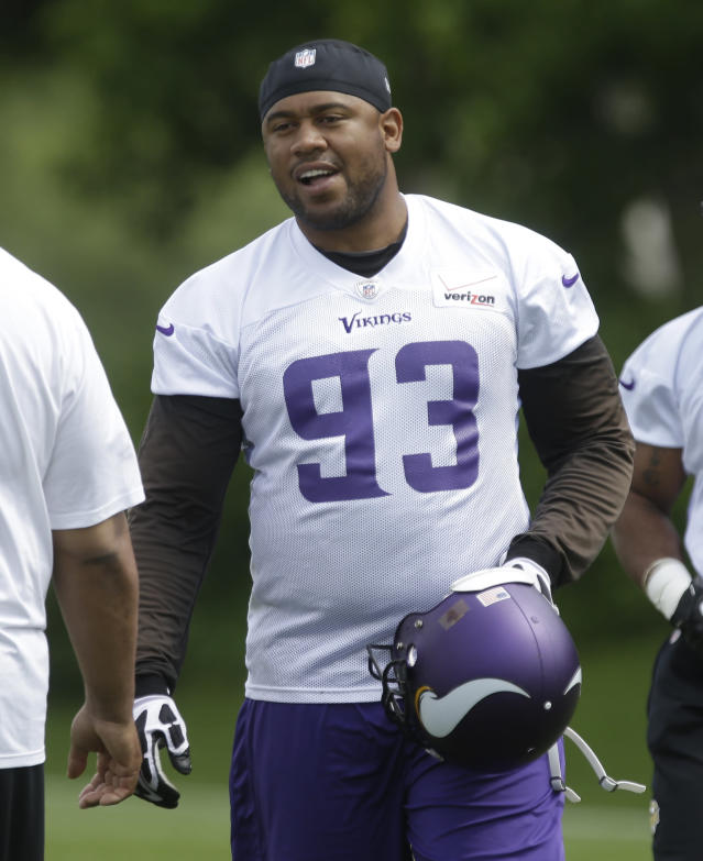 FILE - In this June 20, 2013 file photo, Minnesota Vikings defensive tackle Kevin Williams (93) in a Vikings' NFL football mini-camp in Eden Prairie, Minn. Without Williams in the middle, the Minnesota Vikings defense was powerless to stop Reggie Bush and the Detroit Lions last Sunday, Sept. 8, 2013. They hope to have Williams back this week at Chicago. (AP Photo/Jim Mone, File)