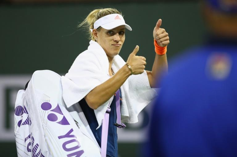 Angelique Kerber of Germany walks off the court after her straight set defeat by Elena Vesnina of Russia in their BNP Paribas Open fourth round match, at Indian Wells Tennis Garden in California, on March 14, 2017
