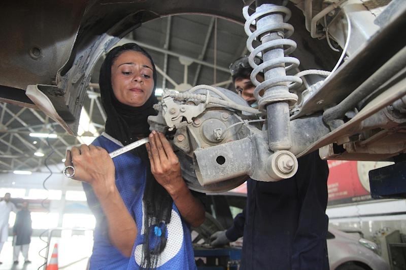 Uzma Nawaz spent years overcoming entrenched gender stereotypes and financial hurdles en route to earning a mechanical engineering degree and netting a job with an auto repairs garage (AFP Photo/S.S. Mirza)