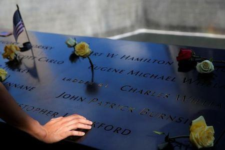 FILE PHOTO: A person touches the south reflecting pool at the National September 11 Memorial and Museum on the 15th anniversary of the 9/11 attacks in Manhattan, New York, U.S., September 11, 2016.  REUTERS/Andrew Kelly