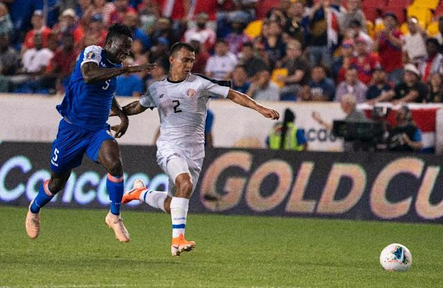 Haiti defender Djimy Bend Alexis (L) fights for the ball with Costa Rica midfielder Randall Leal in Haiti's 2-1 Gold Cup Group B victory at Red Bull Arena (AFP Photo/Don Emmert)