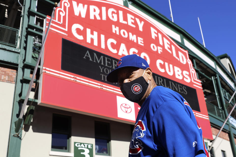 Chicago resident Charlie Moore, 80, poses for a portrait wearing the Chicago Cubs jersey at Wrigley Field on Thursday, March 11, 2021, in Chicago. With limitations, spectators will be allowed to return to the stands at Wrigley Field this season. (AP Photo/Shafkat Anowar)