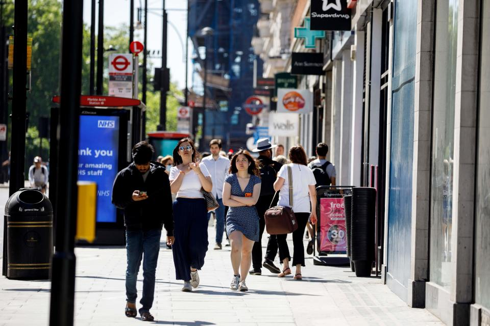 People walk past closed shops on Oxford Street in central London's main high street retail shopping area on May 29, 2020 ahead of some shops reopening from their coronavirus shutdown from next week. - The UK Prime Minister announced on May 28 that some English schools and shops would reopen from next week people would a little more freedom to meet others in public as he tried to plot Britain's path through a health disaster that has officially claimed 37,837 lives -- second only to the United States -- and devastated the economy. (Photo by Tolga AKMEN / AFP) (Photo by TOLGA AKMEN/AFP via Getty Images)