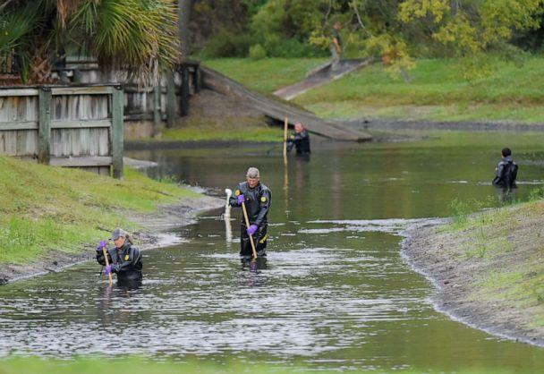 PHOTO: Law enforcement investigators in dry suits search the small retention pond near the entrance of the Southside Villas apartment complex off Southside Blvd. in Jacksonville, Fla., Nov. 6, 2019. (Bob Self/AP, FILE)