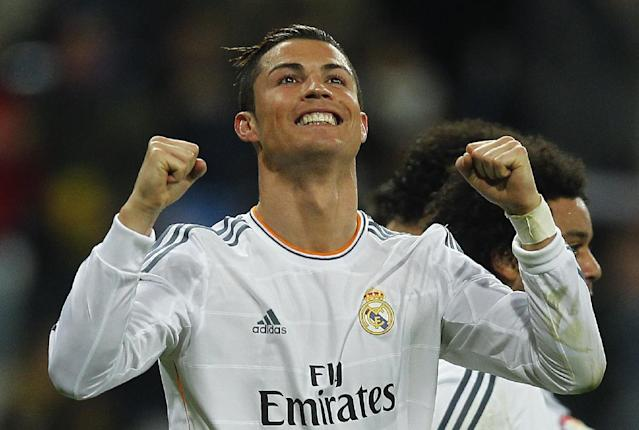 Real Madrid's Cristiano Ronaldo from Portugal celebrates his goal during a Spanish La Liga soccer match between Real Madrid and Celta at the Santiago Bernabeu stadium in Madrid, Spain, Monday, Jan. 6, 2014. (AP Photo/Andres Kudacki)