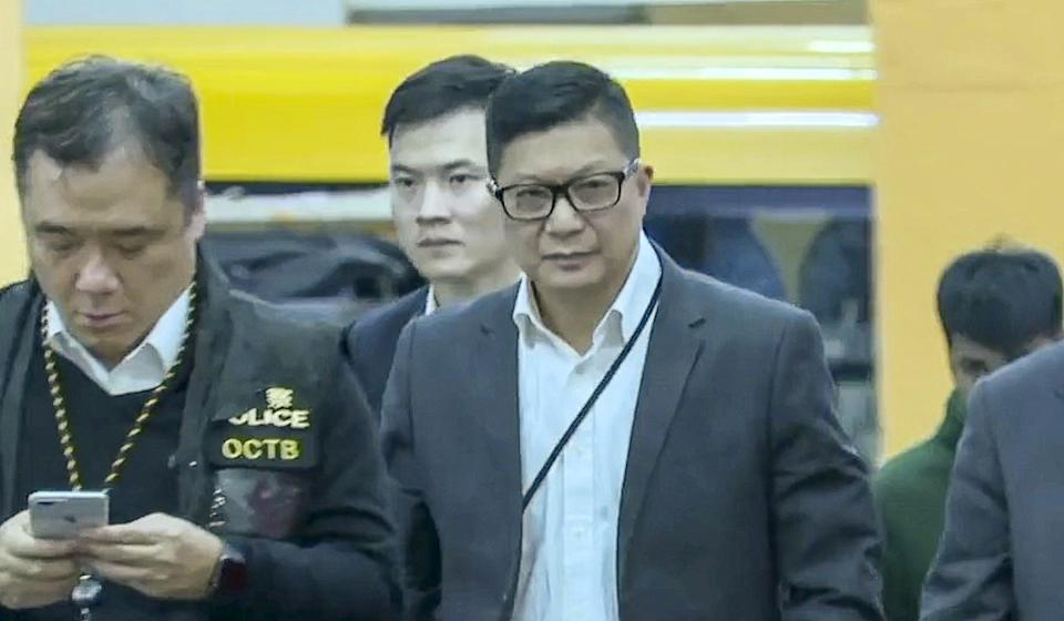 Police chief Chris Tang arrives to inspect the scene of the crime in Tai Po. Photo: RTHK