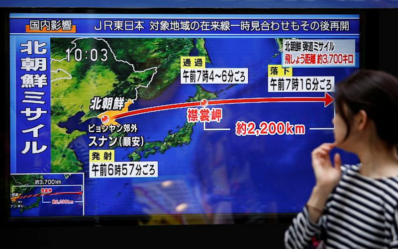 A TV screen in Tokyo shows news about North Korea's missile launch over Japan on Sept. 15, 2017. (Issei Kato/Reuters)