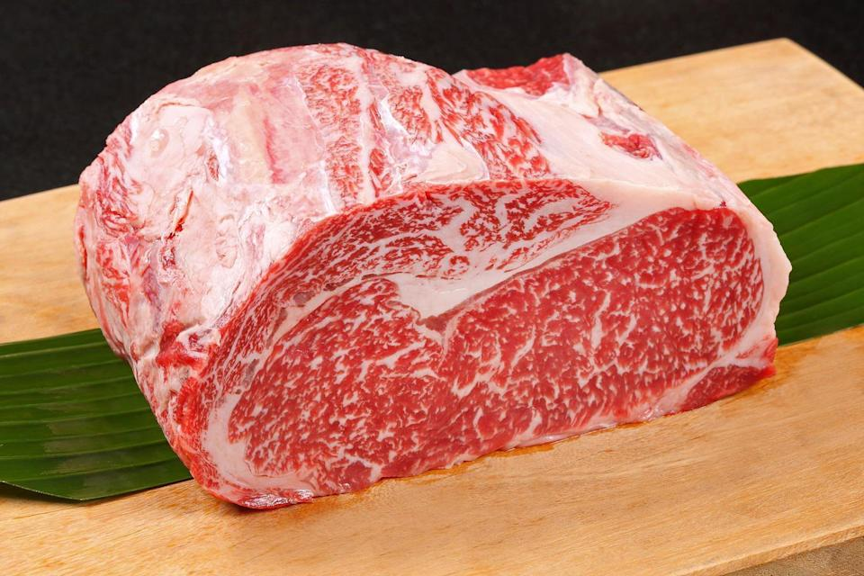 """<p>While the average home cook is going to debate between choice or prime cuts of prime rib, Toups recommended wagyu prime rib if you can find — and afford — it. """"Wagyu goes even further,"""" he said. """"They take these cows, and they really pamper them and feed them a bunch of grain instead of grass. There's always the argument between grass- and grain-fed beef. Grass, which is what they naturally eat, is going to have more of a high-quality beef flavor. Grain is going to give you more of a fat content. So you're always kind of trading. If you go with wagyu, which is grain-fed, it's going to have more fat and it's going to be more luxurious, more melt-in-your-mouth."""" Though there are times when grass-fed is preferable, for standing rib roast, the more marbling the better. However, keep in mind that wagyu prime rib is quite expensive and can be as much as $100 a pound.</p>"""