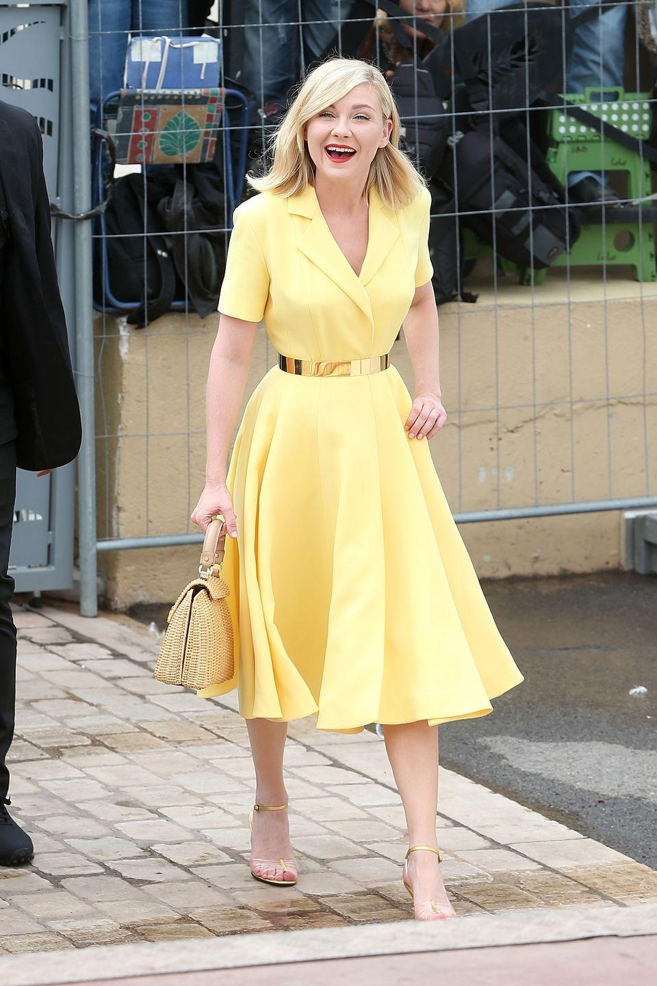 <p>Even though the casual yellow dress Kirsten Dunst wore to the Cannes Film Festival in 2016 is a little bit more '50s than the '20s attire Tiana wears in <em>The Princess and the Frog</em>, the whole look is strikingly similar.</p>