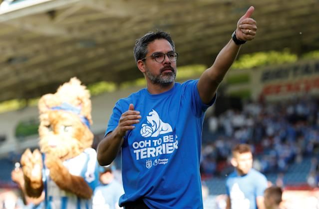 "Soccer Football - Premier League - Huddersfield Town vs Arsenal - John Smith's Stadium, Huddersfield, Britain - May 13, 2018 Huddersfield Town manager David Wagner gestures to the fans at the end of the match Action Images via Reuters/Andrew Boyers EDITORIAL USE ONLY. No use with unauthorized audio, video, data, fixture lists, club/league logos or ""live"" services. Online in-match use limited to 75 images, no video emulation. No use in betting, games or single club/league/player publications. Please contact your account representative for further details."