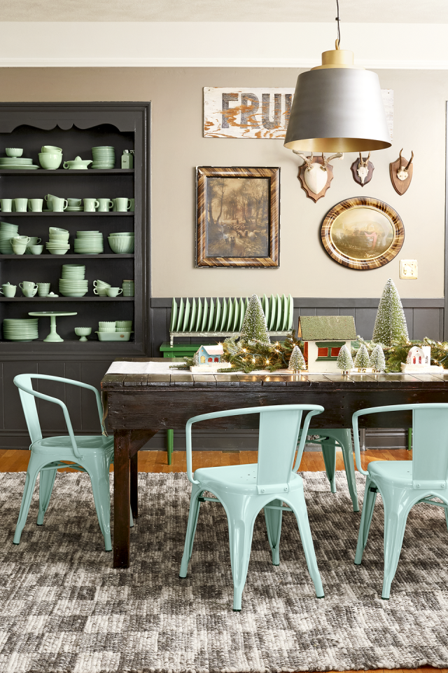 """<p>An eclectic mix of collectibles, vintage treasures, and plenty of bottle brush trees in various shades of green add color to the top of the dining table in <a href=""""https://www.countryliving.com/home-design/house-tours/g4929/farmhouse-packed-christmas-decorating-ideas/"""" rel=""""nofollow noopener"""" target=""""_blank"""" data-ylk=""""slk:this Midwest farmhouse"""" class=""""link rapid-noclick-resp"""">this Midwest farmhouse</a>. </p><p><a href=""""https://www.amazon.com/s/ref=nb_sb_noss_2/138-0002610-0996645?url=search-alias%3Daps&field-keywords=bottle+brush+trees"""" rel=""""nofollow noopener"""" target=""""_blank"""" data-ylk=""""slk:SHOP BOTTLE BRUSH TREES"""" class=""""link rapid-noclick-resp"""">SHOP BOTTLE BRUSH TREES</a></p>"""