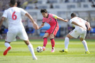 South Korea's Son Heung-min, center, fights for the ball against Lebanon during their Asian zone Group H qualifying soccer match for the FIFA World Cup Qatar 2022 at Goyang stadium in Goyang, South Korea, Sunday, June 13, 2021. (AP Photo/Lee Jin-man)