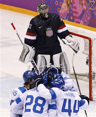 Team USA's goalie Jonathan Quick reacts as Finland's Teemu Selanne (hidden) celebrates his goal with his linemates during the third period of their men's ice hockey bronze medal game at the Sochi 2014 Winter Olympic Games February 22, 2014. REUTERS/Grigory Dukor