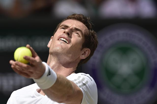 Andy Murray serves to Grigor Dimitrov during their men's singles quarter-final match at The All England Tennis Club in Wimbledon, on July 2, 2014 (AFP Photo/Toby Melville)