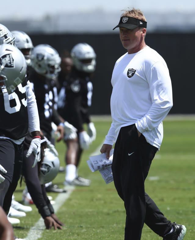 Oakland Raiders coach Jon Gruden, right, oversees an NFL football practice on Friday, May 4, 2018, at the team's training facility in Alameda, Calif. (AP Photo/Ben Margot)