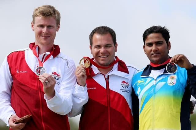 England's Steven Scott won gold in the Men's Double Trap, with England's Matthew French (left) securing silver and India's Asab Mohd (right) bronze at the 2014 Commonwealth Games (Gareth Fuller/PA)