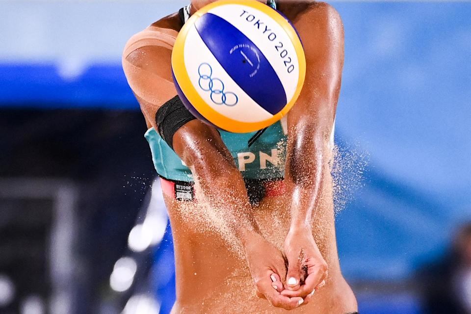 <p>Japan's Miki Ishii hits the ball during the July 26 women's preliminary beach volleyball pool F match between Japan and Germany.</p>