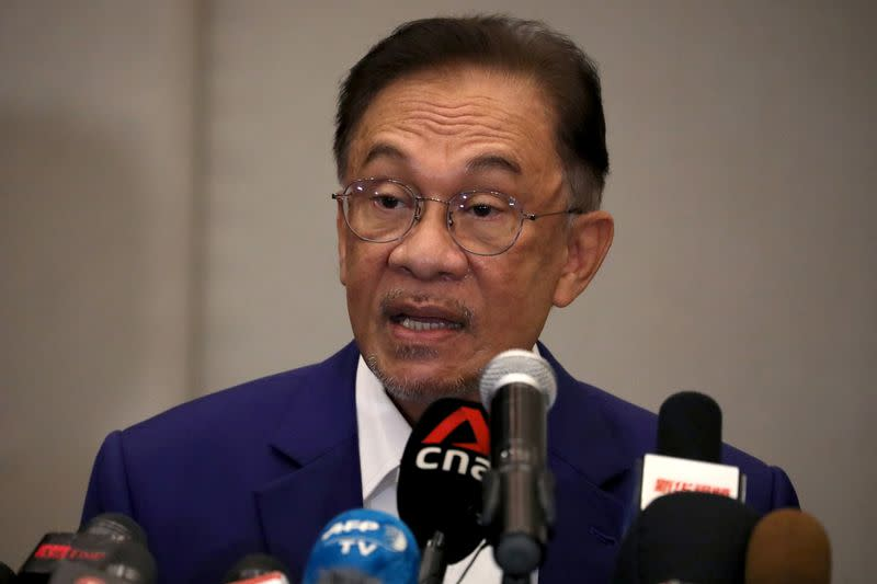 Malaysia opposition leader Anwar Ibrahim speaks during a news conference in Kuala Lumpur
