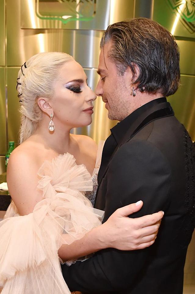 "<p>The singer shared a quiet moment with fiancé Christian Carino backstage at the Grammys. Gaga hit the stage on music's biggest night to give a powerful performance of ""Joanne"" and ""Million Reasons"" during the ceremony. (Photo: Kevin Mazur/Getty Images for NARAS) </p>"