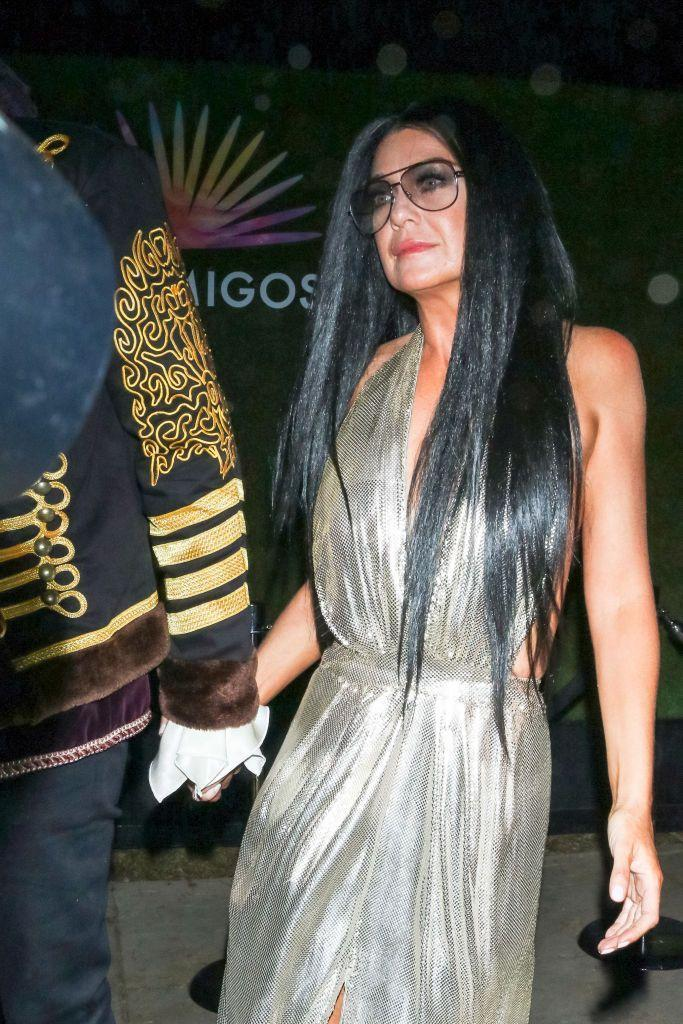 <p>A long black wig and aviator glasses are all it took to transform the Grey's Anatomy star into Cher in 2014.</p>