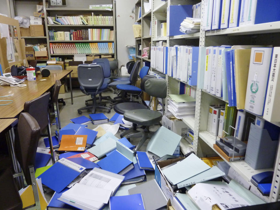 Files are scattered following an earthquake at a meeting room of Kyodo News Sendai branch office in Sendai, Miyagi prefecture, northeastern Japan Saturday, Feb. 13, 2021. The Japan Meteorological Agency says a strong earthquake has hit off the coast of northeastern Japan, shaking Fukushima, Miyagi and other areas. (Kyodo News via AP)