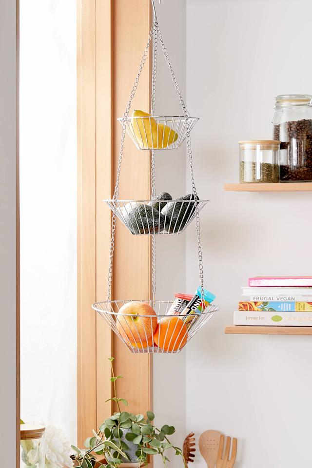 "<p>Fill this <a href=""https://www.popsugar.com/buy/Tully-Trio-Hanging-Kitchen-Basket-498149?p_name=Tully%20Trio%20Hanging%20Kitchen%20Basket&retailer=urbanoutfitters.com&pid=498149&price=49&evar1=moms%3Aus&evar9=45714253&evar98=https%3A%2F%2Fwww.popsugar.com%2Ffamily%2Fphoto-gallery%2F45714253%2Fimage%2F46718613%2FTully-Trio-Hanging-Kitchen-Basket&list1=shopping%2Corganization%2Ckitchen%20organization%2Chome%20organization&prop13=mobile&pdata=1"" rel=""nofollow"" data-shoppable-link=""1"" target=""_blank"" class=""ga-track"" data-ga-category=""Related"" data-ga-label=""https://www.urbanoutfitters.com/shop/tully-trio-hanging-kitchen-basket?category=kitchen-storage-accessories&amp;color=007&amp;type=REGULAR"" data-ga-action=""In-Line Links"">Tully Trio Hanging Kitchen Basket</a> ($49) with all your favorite fruit.</p>"
