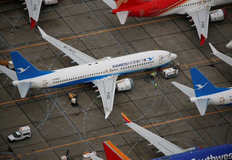 Workers move around a Xiamen Airlines Boeing 737 MAX aircraft at Boeing facilities at Grant County International Airport in Moses Lake