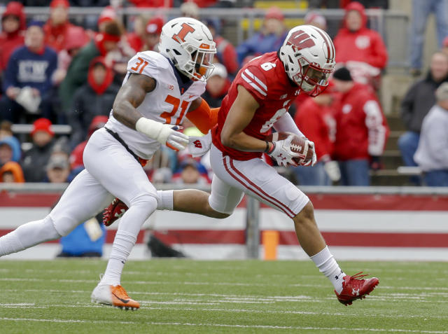 Wisconsin wide receiver Danny Davis (6) makes a reception against Illinois defensive back Cameron Watkins during the first half of an NCAA college football game Saturday, Oct. 20, 2018, in Madison, Wis. (AP Photo/Andy Manis)