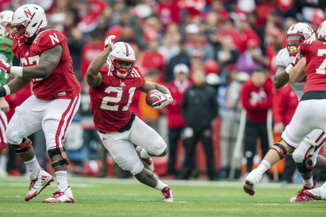 Nebraska Red team Mikale Wilbon (21) runs the ball against the Nebraska White team during the Red/White game in Lincoln, Neb., Saturday, April 21, 2018. (AP Photo/John Peterson)
