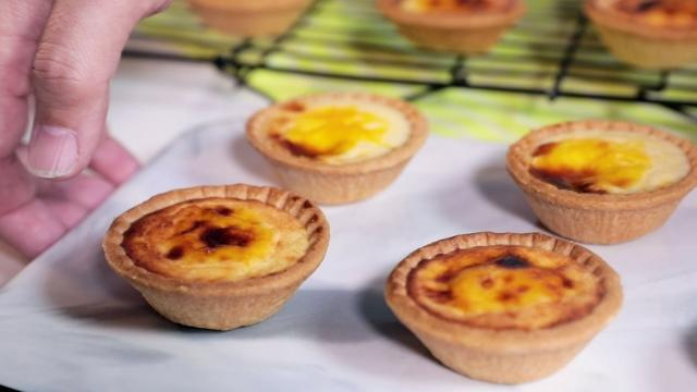 Transfer the cheese tarts into the oven and bake it for 7 minutes or until the top is slightly brown.