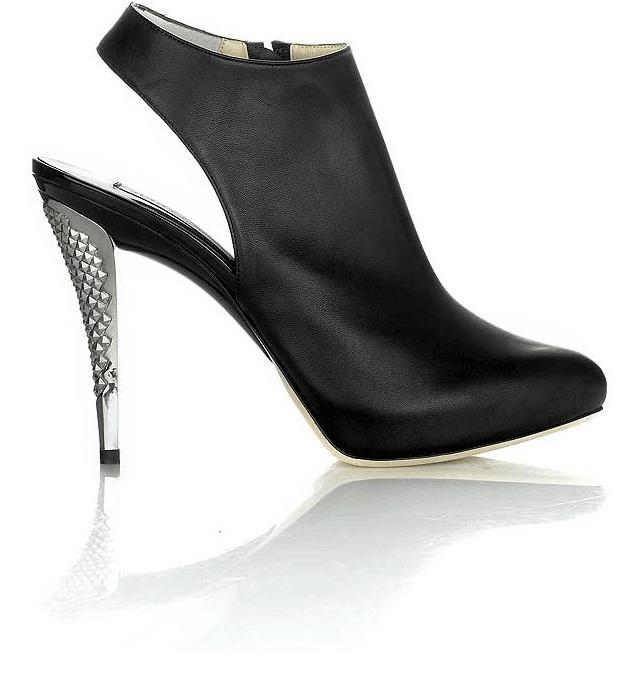 """Photo by: Jimmy Choo boot shoes via Kristopher Dukes<br>Heels that cause accidents, sometimes even when they're not on your feet-<br>Aretha Franklin loves her Jimmy Choos, but they don't love her back. The singer was sent to the hospital with a fractured toe last week after <a href=""""http://www.kristopherdukes.com/2007/10/31/jimmy-choo-boots-shoes"""" rel=""""nofollow noopener"""" target=""""_blank"""" data-ylk=""""slk:she stepped on her spiked Choo shoe."""" class=""""link rapid-noclick-resp"""">she stepped on her spiked Choo shoe.</a> That's right, she wasn't even wearing them when they injured her. Just stepping on one of the heels was so extreme it sent her ankle on a one way train to twist city. <br> <br> Add it to the <a href=""""http://shine.yahoo.com/channel/beauty/wearing-heels-now-linked-to-arthritis-2497044"""" data-ylk=""""slk:annals of accidents"""" class=""""link rapid-noclick-resp"""">annals of accidents</a> caused by architecturally impossible footwear. In April, U.S. Open tennis champ Kim Clijsters tore ligaments in her ankle when she stepped on someone else's foot while wearing heels at a wedding. She had to keep her foot immobile for a month following the misstep. <br> <br> In Australia, a woman was recently awarded around $60,000 after she tripped and fell down the stairs of a hotel she was staying at. Her nude stilettos actually became key evidence in her court case, and stood trial as a considerable cause of the fall. In the end, the judge decided that women were entitled to their heels even if it leaves them more susceptible to accidents. <br> <br> But some shoes are more dangerous than others. We asked the experts of footwear which ones have a higher rate of accidents. Here are the biggest types of problem heels, and some less risky alternatives."""
