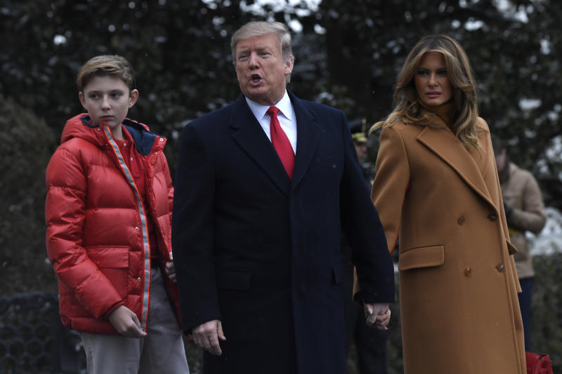 In this Feb. 1, 2019, photo, President Donald Trump, center, first lady Melania Trump, right, and their son Barron Trump, left, walk out of the White House and head to Marine One on the South Lawn of White House in Washington. A woman whose life sentence for drug offenses was commuted by President Donald Trump and a Delaware student allegedly bullied because his last name is Trump are among guests who will sit with first lady Melania Trump for the State of the Union address. (AP Photo/Susan Walsh)