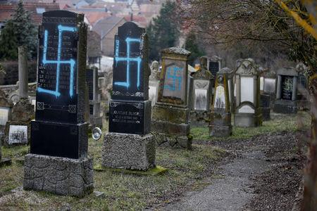 Graves desecrated with swastikas are seen in the Jewish cemetery in Quatzenheim, near Strasbourg, France, February 19, 2019. REUTERS/Vincent Kessler