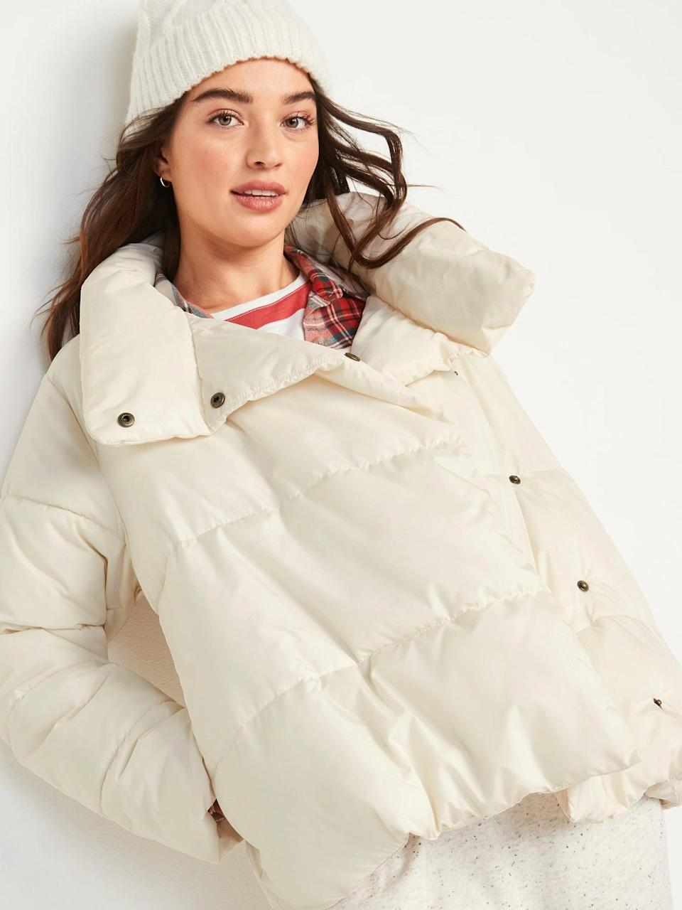 <p>This winter white <span>Old Navy Water-Resistant Double-Breasted Puffer Jacket</span> ($60) is so cute. Throw it on with a matching white beanie for a seasonal look.</p>