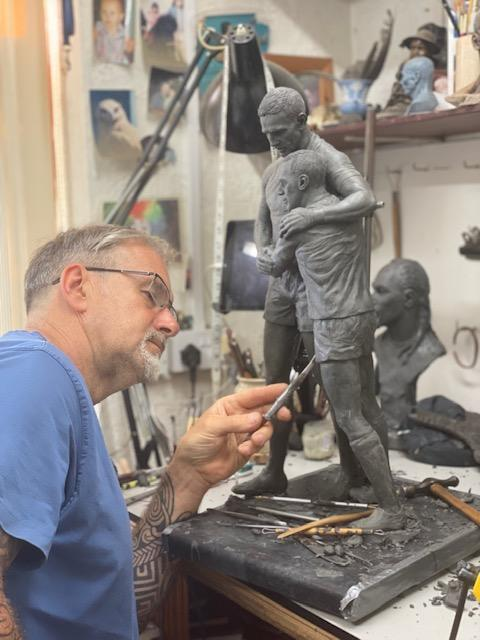 Sculptor Steve Winterburn works on a preliminary model of the statue