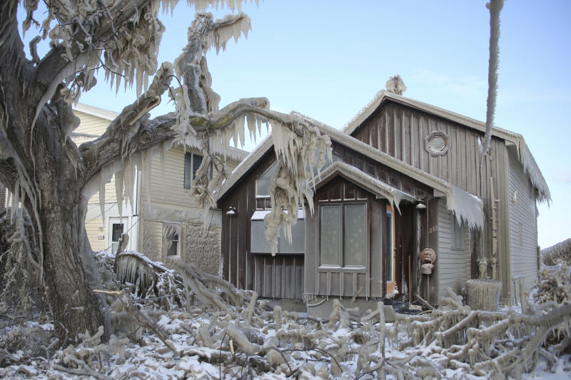 A house along Hoover Beach is covered by ice from high winds and from the waves from Lake Erie, Saturday, Feb. 29, 2020, in Hamburg N.Y. Blowing snow has fallen around the state since Thursday, though the heaviest snowfall was concentrated in largely rural areas east of Lake Erie and Lake Ontario. (AP Photo/Jeffrey T. Barnes)
