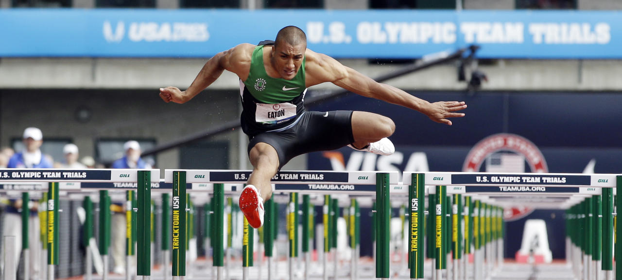 Ashton Eaton competes in the 110m hurdles during the decathlon competition at the U.S. Olympic Track and Field Trials Saturday, June 23, 2012, in Eugene, Ore. (AP Photo/Morry Gash)