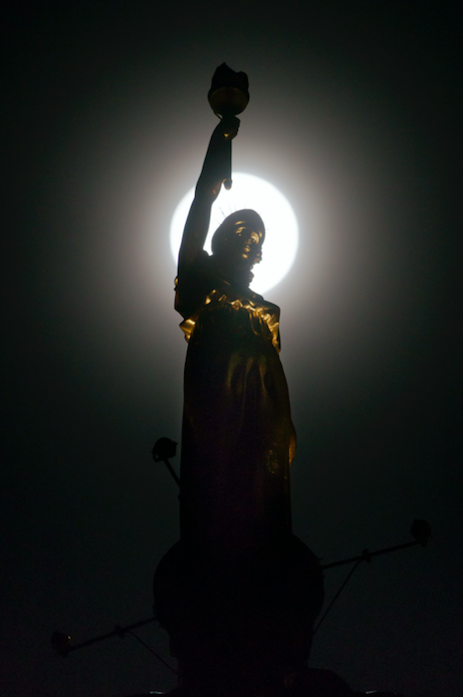 <p>The supermoon was pictured behind Kenny Mackay's sculpture, named Light and Life, on Morrison Street, Glasgow, Scotland. (PA) </p>
