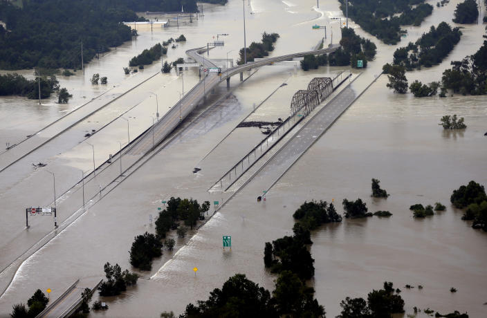 """<span class=""""s1"""">Interstate 69 is covered by water at the San Jacinto River bridge in Humble, Texas, on Aug. 29. (Photo: David J. Phillip/AP)</span>"""