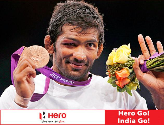 India's Yogeshwar Dutt poses with his bronze medal at the podium of the Men's 60Kg Freestyle wrestling at the ExCel venue during the London 2012 Olympic Games August 11, 2012.                      REUTERS/Suhaib Salem