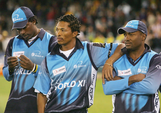 MELBOURNE, AUSTRALIA - OCTOBER 09:  (L - R) Chris Gayle, Makhaya Ntini and Brian Lara of the ICC World XI look on during the presentations after losing the series 3 - 0 after Game Three of the Johnnie Walker Super Series between Australia and the ICC World XI  played at the Telstra Dome on October 9, 2005 in Melbourne, Australia.  (Photo by Hamish Blair/Getty Images) *** Local Caption *** Chris Gayle;Makhaya Ntini;Brian Lara