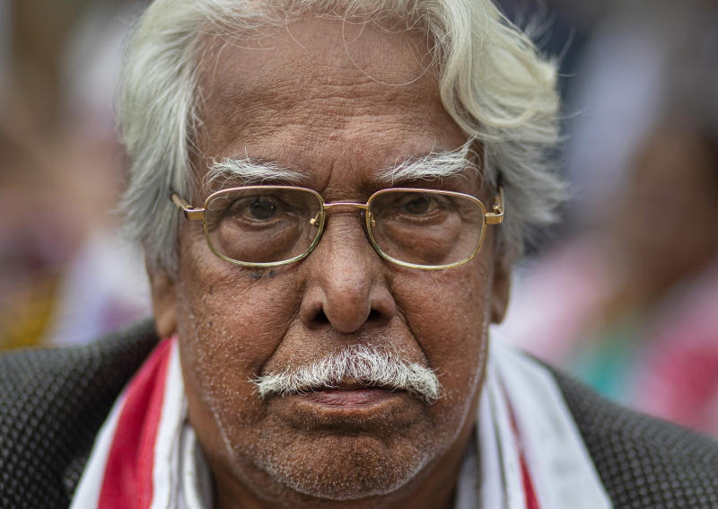 """In this Monday, Dec. 23, 2019, photo, Nityananda Phukan, 77, participates in a protest against the Citizenship Amendment Act (CAA) in Gauhati, India. Tens of thousands of protesters have taken to India's streets to call for the revocation of the law, which critics say is the latest effort by Narendra Modi's government to marginalize the country's 200 million Muslims. Phukan demanded that the government withdraw the act immediately. """"I am ready to take bullet in my chest but will not allow the CAA to be implemented,"""" he said. (AP Photo/Anupam Nath)"""