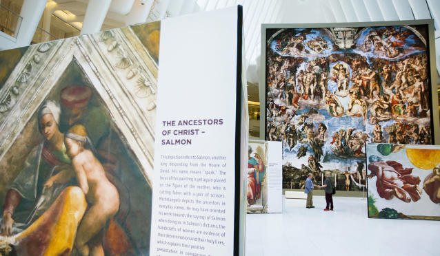 "<p>Guests explore the ""Up Close: Michelangelo's Sistine Chapel"" re-creation exhibit at the Oculus at Westfield World Trade Center in New York. The exhibit features 34 reproductions, including ""The Creation of Adam"" and ""The Last Judgement."" (AP Photo/Michael Noble Jr.) </p>"