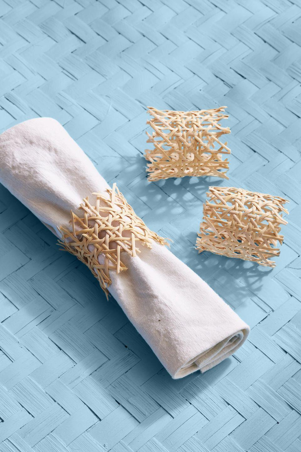 <p>Dress up your table with these oh-so simple to make napkin rings.<br><strong><br>To make: </strong>Cut out a piece of caning that is 8 inches long by 2 1/2 inches tall. Use hot-glue to adhere the ends together, creating a ring. If desired, remove some of the cross canes to create a loose edge.</p>