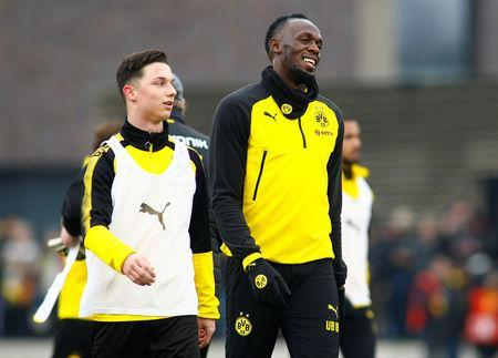 Soccer Football - Usain Bolt participates in a training session with Borussia Dortmund - Strobelallee Training Centre, Dortmund, Germany - March 23, 2018 Usain Bolt during Borussia Dortmund training REUTERS/Thilo Schmuelgen